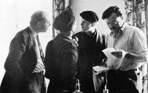 Dos Passos a un lado, Hemingway a otro, y milicianos en medio.
